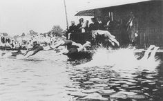 A highly unusual, yet undeniably fun race, swam over 200 meters. Competitors first had to swim to a pole, climb up and down the pole, then swim a bit, clamber over 2 boats, swim under two more boats, and then swim to the finish. This was held only once, during the 1900 Olympics, and was won by Frederick Lane of Australia.