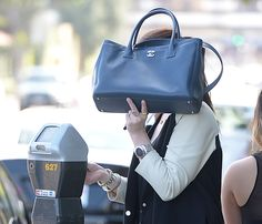 Hello beautiful. By that I mean the Chanel Cerf Tote. Not.. the Michelle who behind the bag :)