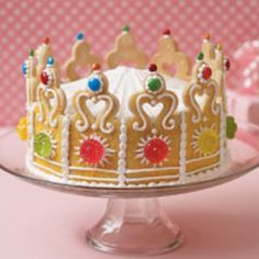 Perfect for almost any party theme, this jewel of a cake will make your little princess feel like a birthday queen.  Ingredients  2/3 cup flour  16 1/2-ounce roll refrigerated sugar cookie dough  Template for cookie pattern  4 tablespoons yellow decorating sugar  2 (16-ounce) cans white frosting  Candy decorations (we used regular and mini M's, and Stardrops hard candies)  2 (8-inch) round cakes  Instructions   Knead the flour into the cookie dough to firm it