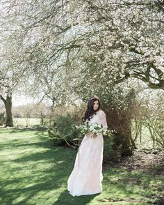 S P R I N G | T I M E _ Spring is right around the corner and this stunning image by @katrinabartlam from our #fineart inspiration shoot last week has got me very excited for wedding season! Everything about this look is perfect; I am utterly in love with the free-flowing bouquet from @bride_and_bloom and the way the ribbon is caught in the breeze. This is one of my favourite gowns that I've seen this year - with beautiful lace sleeves a gorgeous bow tied behind and glimpses of the beautiful…