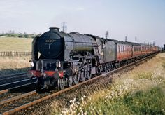 A1 Pacific 60145 'Saint Mungo' (built Darlington 3/49) southbound out of Grantham (I think!) with an up express, 7/62.