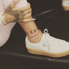 There has been a resurgence of 90s trends of late, and now Millennial celebs are etching birth year tattoos into their influential skin.