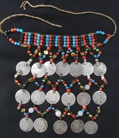 Africa | Old Berber Pectoral – Middle Atlas, Morocco | Mid 20th century | Silver coins and glass beads. Silver coins range between 1882 and 1913 (1299-1331 Hegira)