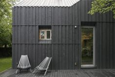 a Dark treated/painted (?) wood exterior .. with reglit?