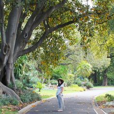 Walking through the beautiful botanical gardens of Melbourne. Spring time. Summer hat and cropped flowing trousers.