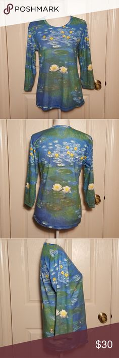 Breeke Monet Water Lilies 3/4 Sleeve Art Tee Breeke Monet Water Lilies 3/4 Sleeve Art Tee Excellent Pre-loved Condition! Hand Silk Screened; absolutely beautiful! 65% Polyester, 35% Cotton  Size Large Breeke Tops Tees - Long Sleeve