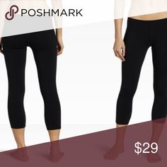 Solid Black Capris Yoga waist band style.  Material: 92% Polyester, 8% Spandex.   OS fits Size 2-10 TC fits size 12-20  Price firm unless bundled.  Not a LulaRoe Solid Black leggings. Tagged as LulaRoe brand for exposure only, not LLR. Pants Capris