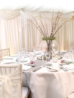Silver sequin table runners sparkle and shimmer on this beautiful wedding guest table. Chiffon chair sashes look very chic and super stylish. All items available in the Hire Collection. www.pamelladunn.co.uk