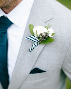 These lapel lovers, which add personality to a groom's or groomsmen's outfit, have moved beyond a single rose and are now often comprised of a flower and another element like seeded eucalyptus, berries, and small fruit like kumquats.        ✔Groom        ✔Best man        ✔Groomsmen        ✔Ushers        ✔Grandfathers        ✔Ring bearer
