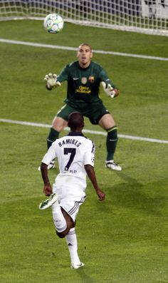 Ramires chips the Barcelona's goalkeeper to keep the dream alive in the 2012 Champions League