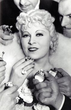 """Mae West """"I never worry about diets. The only carrots that interest me are the number you get in a diamond."""" """"Love thy neighbor - and if he happens to be tall, debonair and devastating, it will be that much easier."""" """"Ten men waiting for me at the door? Send one of them home, I'm tired"""""""