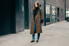 Giorgia Tordini wearing an oversized coat and Gucci loafers after a show in Milan, Italy
