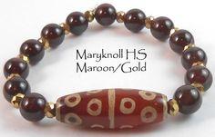 "Jan O Designs - Old DZI Stone Bead Bracelet - 7"" 13 Eyed DZI w/Garnet - Maryknoll School Maroon/Gold, $50.00 (http://www.janodesigns.com/old-dzi-stone-bead-bracelet-7-13-eyed-dzi-w-garnet-maryknoll-school-maroon-gold/)"