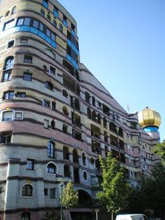 Waldspirale Darmstadt, Germany... I remember seeing this building a few years ago when I went to a large fair. Every window on this building is different. Beautiful to see up close.