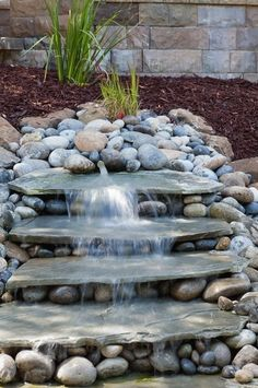 76 Backyard and Garden Waterfall Ideas I love the pondless waterfall features due to their simplicity and ease of setup and design. Pavers of all shapes and sizes are fun to shop for and choose based on your color and textual preferences. Outdoor Water Features, Water Features In The Garden, Backyard Water Feature, Ponds Backyard, Small Garden Waterfalls, Backyard Ideas, Backyard Patio, Koi Ponds, Outdoor Fish Ponds