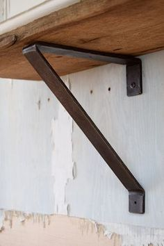 "Hand-hammered metal shelf bracket with blackened iron finish. Heavy-duty industrial look and feel. This shelf bracket measures 11"" x 9"" x 1 1/2"". We recommend a shelf bracket every 36 inches. These brackets are very strong and will hold heavy items such as pots, pans, and dish-ware when installed properly. All our brackets are made to order. Please allow approximately 2 to 3 weeks for delivery. Brackets sold separately. Shelves sold separately. Blackened screws included.  ..."