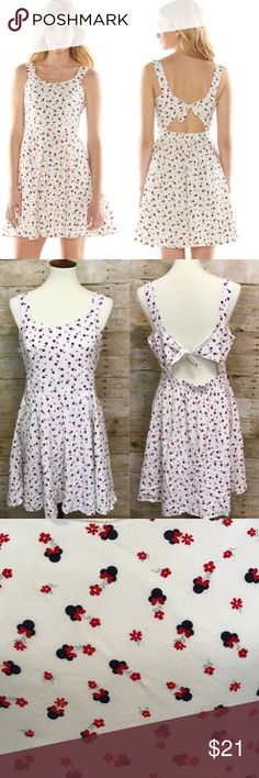 """LC Lauren Conrad Disney Dress Mickey Mouse White Very cute Disney collection LC dress. Has a cut out back with tie.   *There is one area at the top neckline where there is a very light staining, possibly makeup. The dress has been washed, although I have not attempted to stain remove it. It is quite light and not very noticeable unless you are looking closely- see close up photo. Price lowered due to this.*   Measurements: Armpit-Armpit: 18.5"""" Waist (flat across): 15"""" Length (Shoulder-Bottom…"""