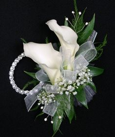 Two elegant Calla Lilies create this contemporary wristlet accessory. Includes keepsake Rhinestone wristlet, crystal pins, and accents! Approximate size is x Custom Colors available , Select Flower color below Prom Corsage And Boutonniere, Corsage Wedding, Wedding Bouquets, Boutonnieres, Prom Flowers, Bridal Flowers, Send Flowers, Flower Corsage, Wrist Corsage