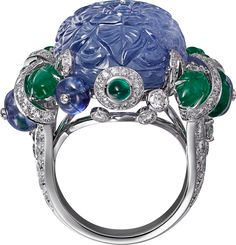 """CARTIER. """"Amritsar"""" Ring - platinum, one carved sapphire of 49.23 carats from Burma, cabochon-cut sapphires and emeralds, carved emeralds, brilliant-cut diamonds. #Cartier #CartierMagicien #HauteJoaillerie #HighJewellery #FineJewelry #CarvedStones #TuttiFrutti #Emeralds #Sapphires #Diamonds"""