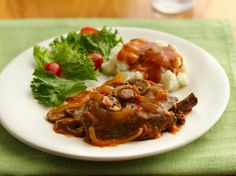 Slow Cooker Smothered Swiss Steak - this recipe reminds me of my Grandma Bergie