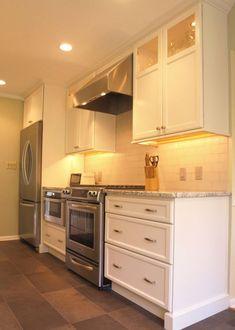 5322 white kitchen with large center island. Kitchen Layout: L ...