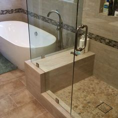 Travertine natural stone bathroom remodel. With modern glass shower and free standing bathtub