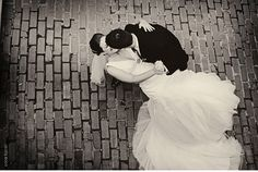 gorgeous photo of the bride & groom - love the contrast between the happy couple and the symmetry of the cobbles behind them