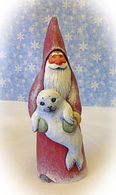 Original, hand carved Santa holding seal pup by Susan M. Smith