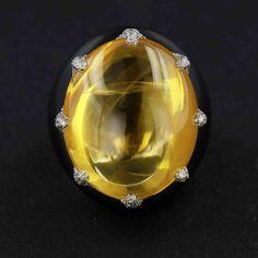 James Taffin. Cabochon natural yellow sapphire, diamond and black jade ring.