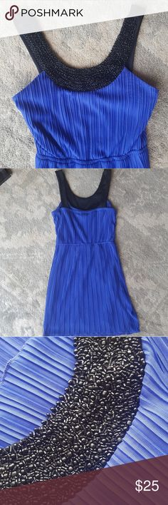 Royal Blue and Black Dress with Beading Trixxi Royal Blue with Black Beading dress! Size 3. Only worn once to a conference. Super cute with a black blazer and heels! Cinched waiste! All beads intact! It's comes to my Mid Thigh and I am 5'4. It has beading around the neck in the front but none in the back. Very flattering! Let me know if you have any questions! Trixxi Dresses Midi