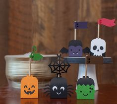 """Halloween Cake Pop Wrappers - Have the spookiest suckers in town! Finished sucker wrapper measures 1.5"""" W x 1.5"""" H. File makes 5 sucker wrappers. Images are from the Creepy Critters digital cartridge. - Dezi Moss"""