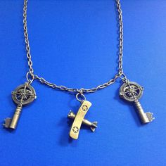 Antique Bronze Necklace with Biplane, Keys, and Compass' by CutesyandFun on Etsy