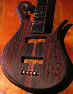 Front of the custom 5 string bass guitar after the first coat of Teak oil, flame figure can be seen on the macassar ebony