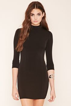 Style Deals - A knit mini dress featuring a mock neck, 3/4 sleeves, and a form-fitting silhouette.