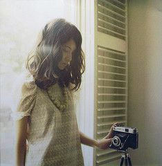 A girl with a vintage camera