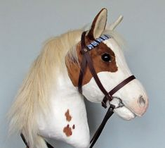 Hobby Horse with open mouth. Skewbald hobby horsing horse (stick horse). Removable leather bridle with bit.For older children and teenagers.