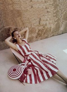 Coco Chanel in Vogue, 1950. ... If Chanel bags still looked like this one ....fashion style color photo print ad designer red white stripes dress purse target sundress day casual picnic 50s