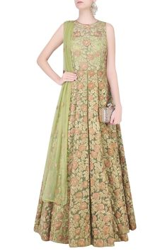 Description Featuring an olive green fit and flared anarkali in net base with peach and gold floral thread embroidery highlighted with sequins embellishment all over the front and back. It is paired with matching olive green net dupatta with floral bootis scattered all over. FIT: Cut for relaxed fit. COMPOSITION: Net.