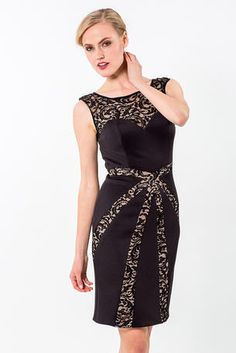 Fitted cocktail dress with lace overlay at the neck that continues into a sweetheart neckline and complimented by diagonal lace pannels starting at the waist and extending toward the hemTerani Cocktail - 1523C1102