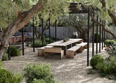 Make this out of reclaimed wood for your front yard. Benches seat more people than chairs. One long table encourages conversation and group interaction.