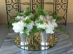 The Silver Julep Container, 6 inches tall used here in a set of 4 with a single White Cymbidium Orchid surrounded by White Carnations.