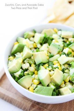 Zucchini, Corn, and Avocado Salsa Recipe on twopeasandtheirpod.com You will fall in love with this fresh and simple summer salsa! It is SO g...