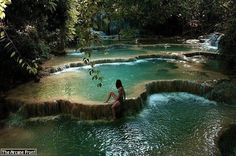 Erawan National Park (7-Tiered Waterfall), Kanchanaburi, Thailand  Erawan Falls has 7 levels dropping down over 1,500m (approx. 4,921 ft.). You can walk to each level fairly easily on the paths but if you're aiming to get to the very top, it's a bit of a challenge up the cliff, but worth the effort.  Around the park are several caves where one can explore and observe some unusual limestone formations, stalagmites, and stalactites...