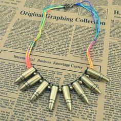 Florescent Bullet Necklace by SunKissedCollections on Etsy, $14.99