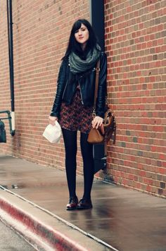 flashes of style. leather biker jacket on print dress, black tights and burgundy oxfords.