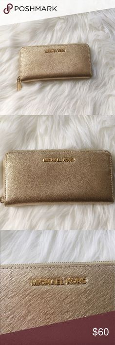 "Michael Kors Soft Gold Leather Zipper Wallet Excellent condition, like-new. Michael Kors Soft Gold Leather Zipper Wallet. Measures 8""x4"". 8 card slots inside. The perfect neutral to match any bag! No modeling/trades. Michael Kors Bags Wallets"