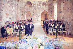 Groom waits at Lulworth Castle wedding ceremony. Photography by one thousand words wedding photographers