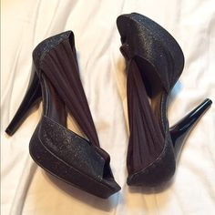 Madden Girl Heels Black Madden Girl high heels! Size 7.5 with elegant fabric and lots of sparkle! 1/2 inch platform and 5 inch heel. Very easy to walk in!! I've worn these a couple times to dinner. Minimal wear and has lots of life left in them! I gorgeous heels!!!  Madden Girl Shoes Heels