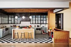 Check: The home has a formal dining room with a large wooden Ralph Lauren table and antique furnishings but the hub of the family's meals would no doubt occur in the large kitchen which has a diner meets today feel to it