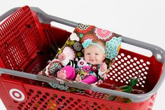I want one! Shopping cart hammock for before the baby can sit up on their own. Now you don't have to lug the stroller/infant carrier AND the cart.